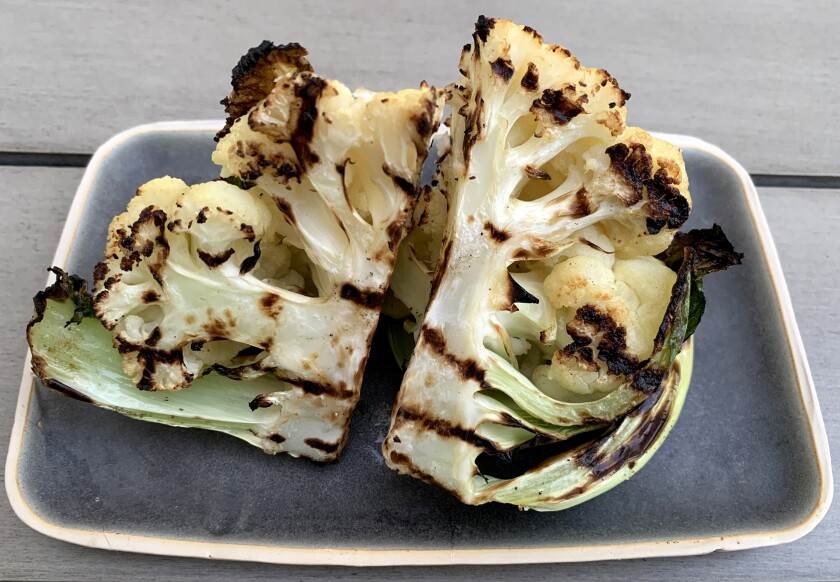 Olive oil, salt and pepper give grilled cauliflower a rich, savory taste that pairs with anything else you're serving.