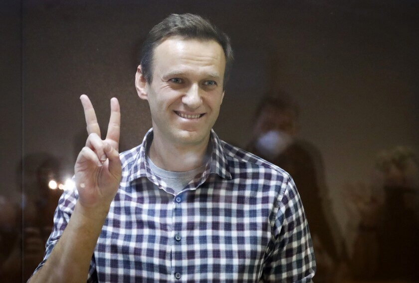 Russian opposition leader Alexei Navalny flashing victory sign
