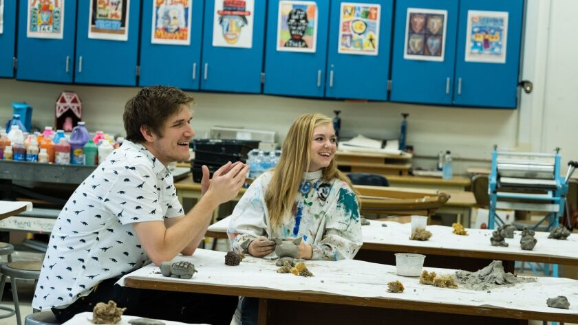 "(L-R) - Bo Burnham and Elsie Fisher on the set of ""EIGHTH GRADE."" Credit: Linda Kallerus /"