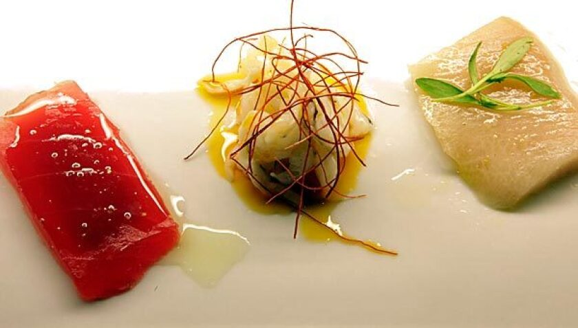A crudo plate, as garnished by the chef.