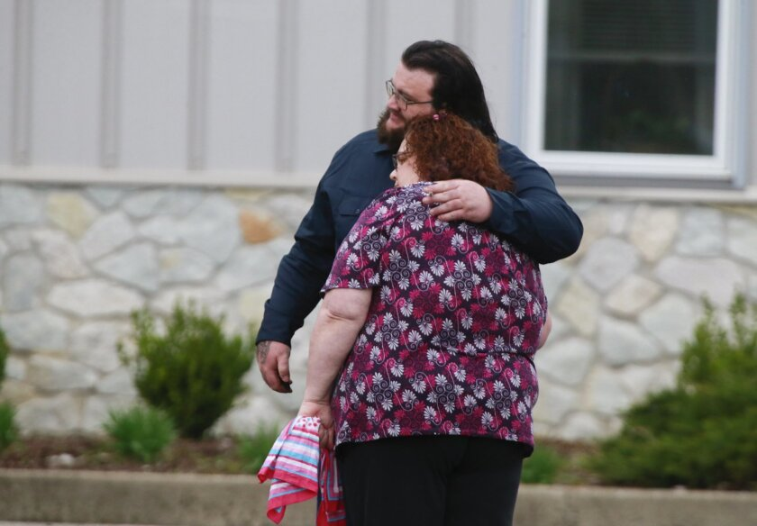 Tamera Morgan, grandmother of Shaylyn Ammerman, right is hugged by Adam Ammerman, (uncle of Shaylyn) during the funeral of Ammerman in Spencer, Ind., Wednesday, March 30, 2016. Mourners joined family members at a visitation ahead of the funeral Wednesday evening for the Indiana toddler who was found slain last week after police say she was abducted from her father's home. (Jeremy Hogan/The Herald-Times via AP) MANDATORY CREDIT