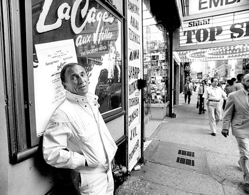 """Arthur Laurents in 1984 outside the Broadway theater where """"La Cage aux Folles"""" was staged."""