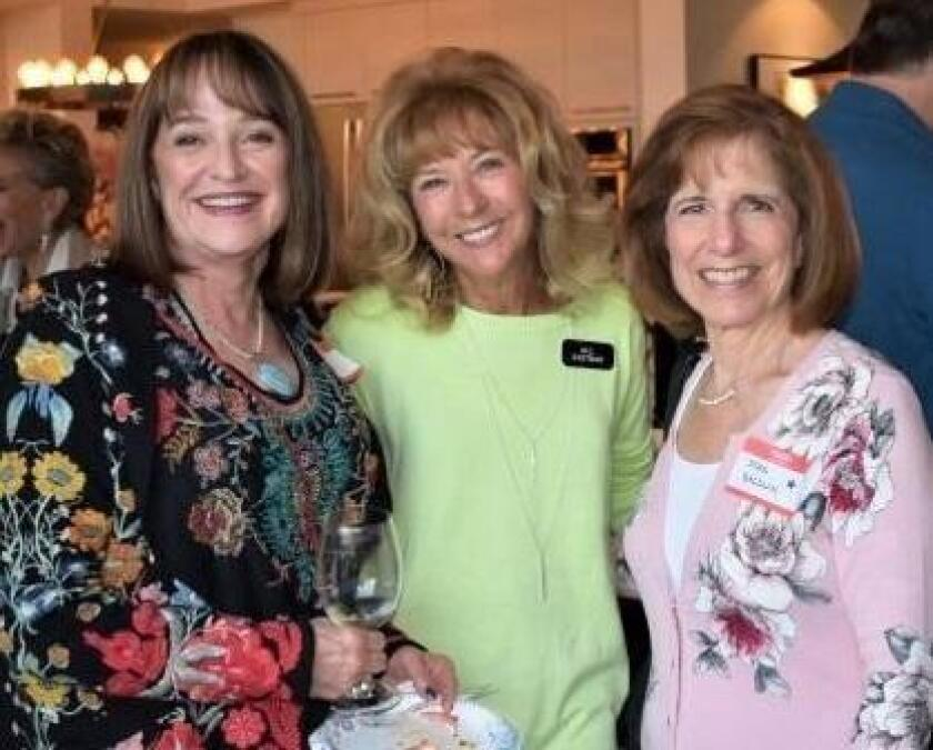La Jolla Newscomers Club members Nancy Pfleg, M.C. Eastman and Doris Baldwin at a wine social