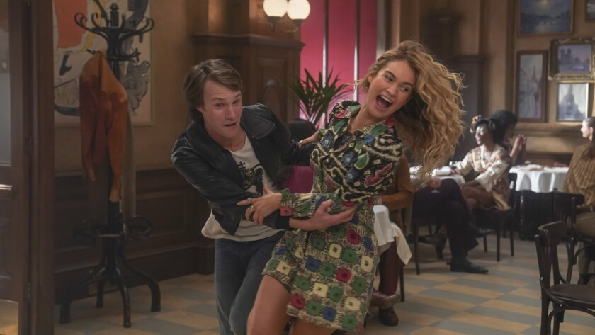 Hugh Skinner as Young Harry and Lily James as Young Donna in Mamma Mia! Here We Go Again (2018)