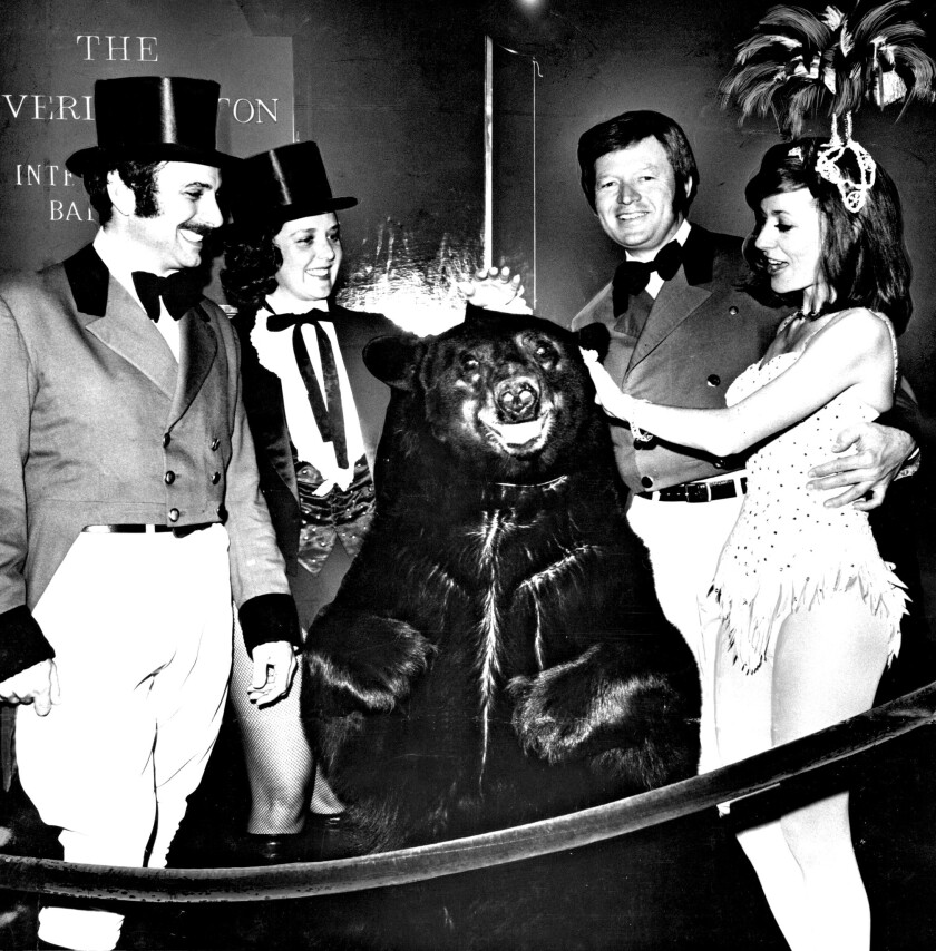 "Bruno the bear is a star attraction at the 1973 Bachelors Ball, themed ""circus daze."" Bestowing attention (and Tootsie Rolls) are, from left, Valerio Giannini, Suzanne Murphy and Dr. Kingsley Fife along with Delores Thedford."