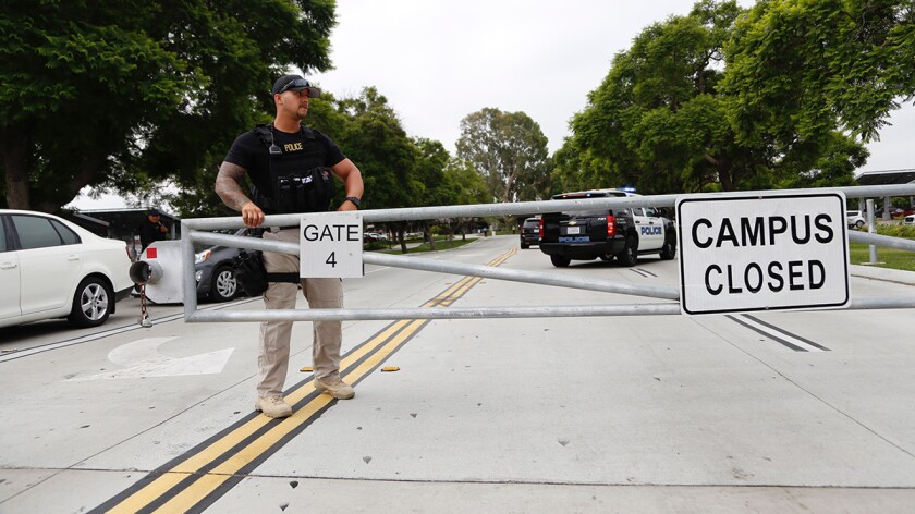 Campus police close the gate onto campus at Southwestern College and Otay Lakes roads.