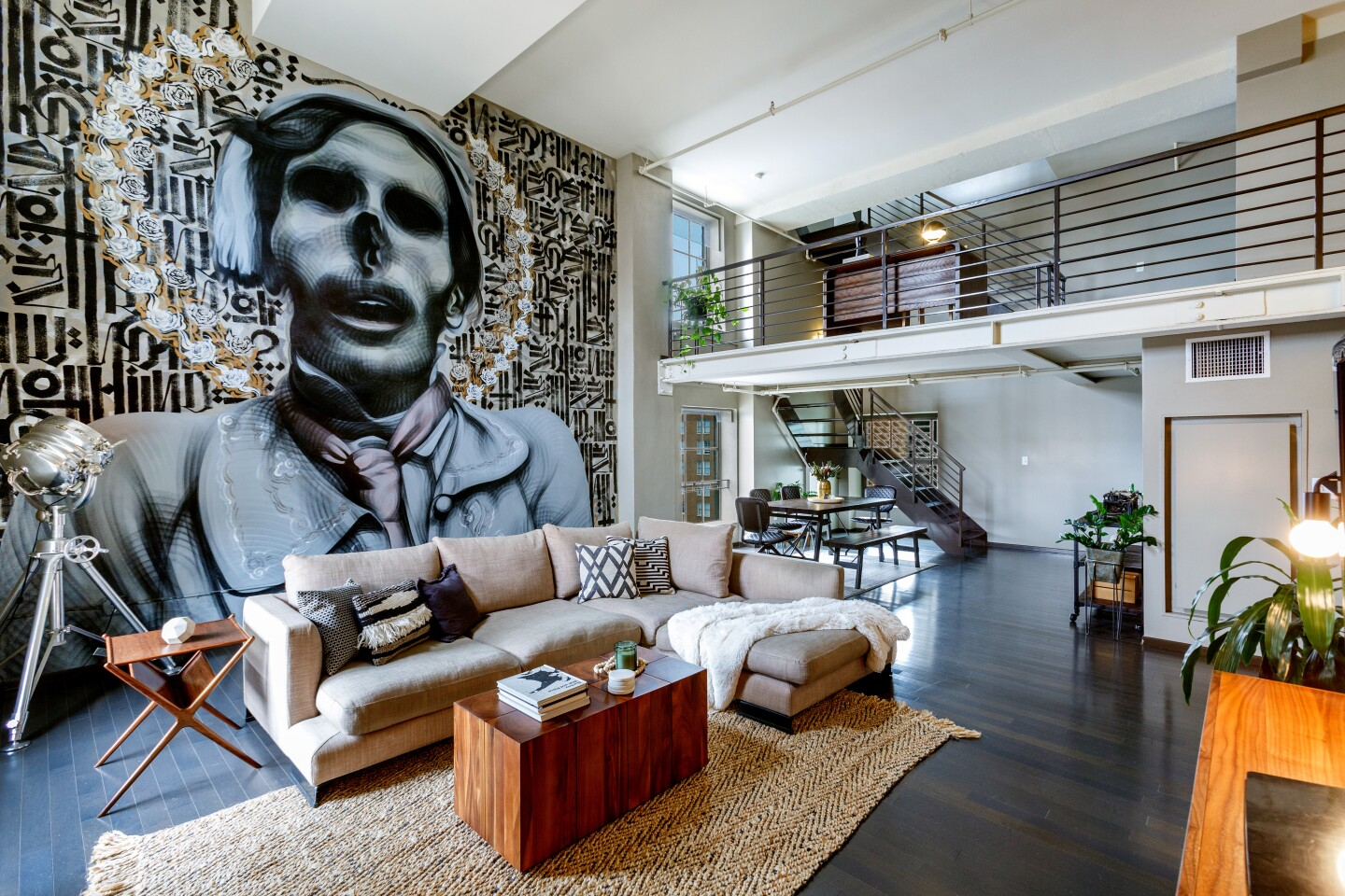 Located within the Broadway Hollywood Building, which was once a department store, the loft-style condominium blends industrial notes with a range of modern updates. High ceilings and gallery walls in the main living area created the perfect canvas for the mural by contemporary street artist Retna. The 2,510-square-foot unit features a chrome-clad chef's kitchen, lofted living space and a private terrace.