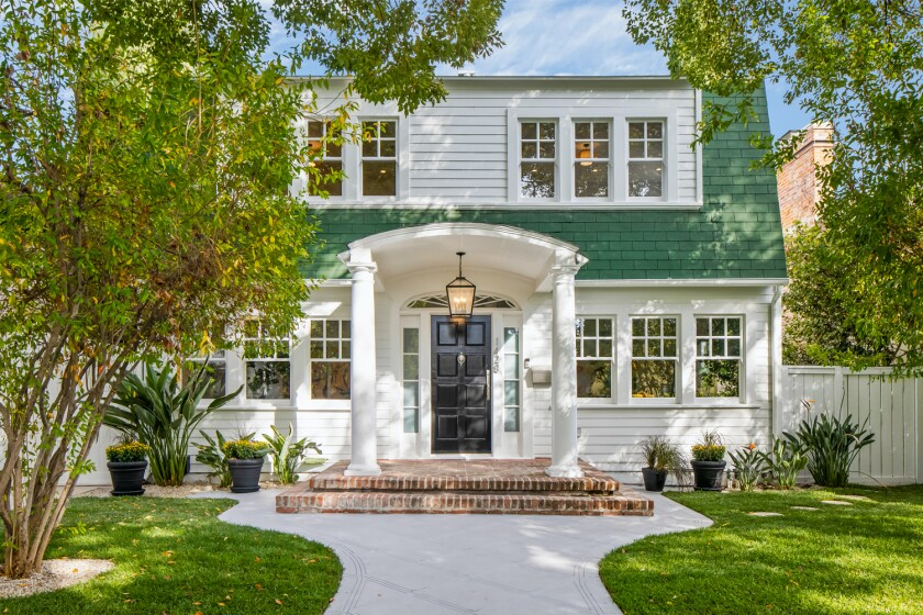 Built in 1919, the Dutch Colonial-style home still features the iconic green-shingled facade that appeared in the 1984 film.