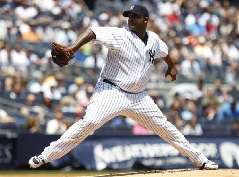 61cef0efe New York Yankees  CC Sabathia delivers a pitch during the first inning of a  baseball