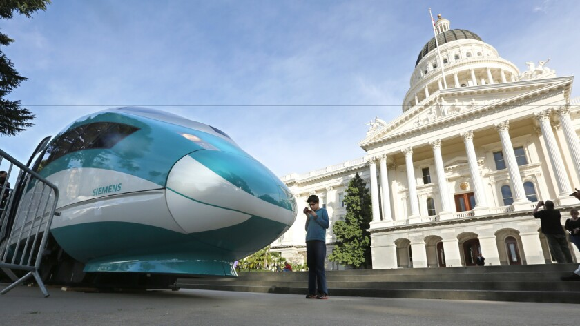 A high-speed train mock-up sits outside the Capitol in Sacramento last year. The state rail authority is counting on greenhouse gas fees to help pay for the high-speed rail project.
