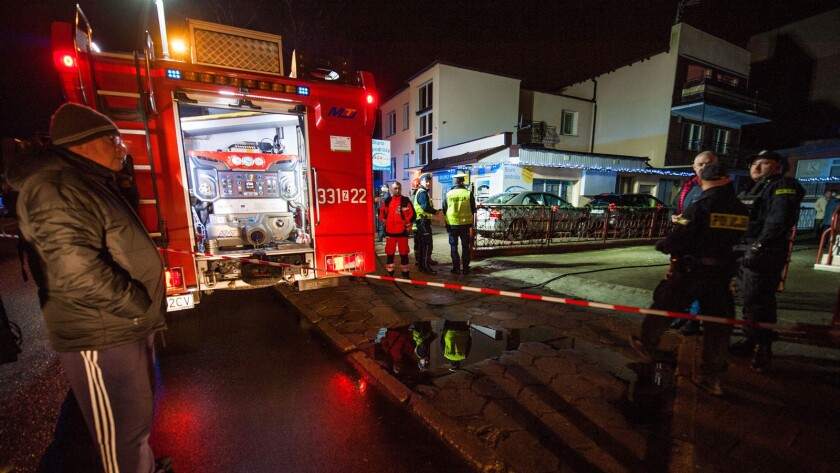 """Police and firefighters at the scene where a fire broke out at an """"escape room"""" in the northern Polish city of Koszalin on Wednesday, leaving five teenage girls dead and one man injured."""