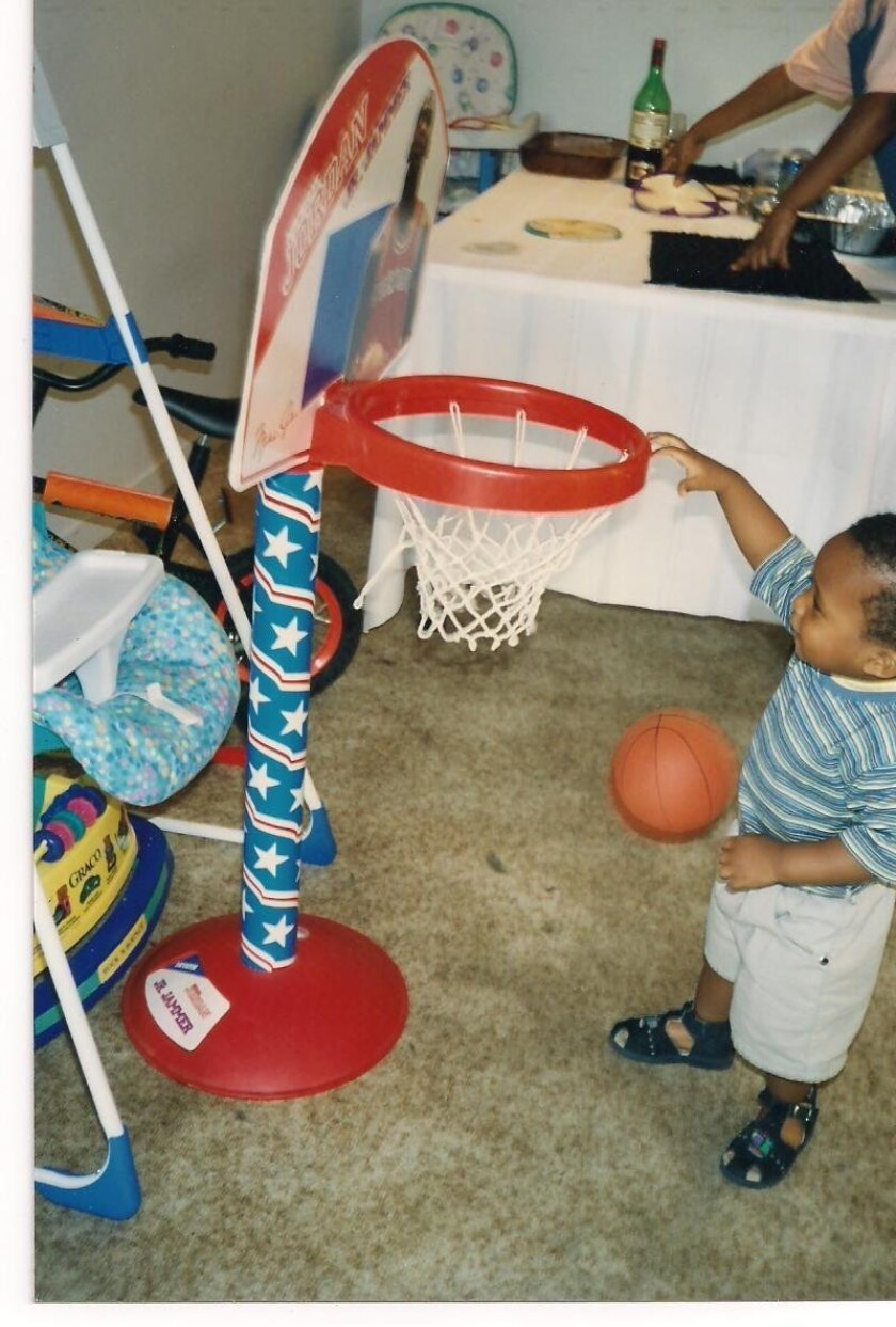 SDSU freshman point guard Kevin Zabo, at age 1, dunking on his Michael Jordan mini-hoop in the living room. Photo courtesy of Zabo family.