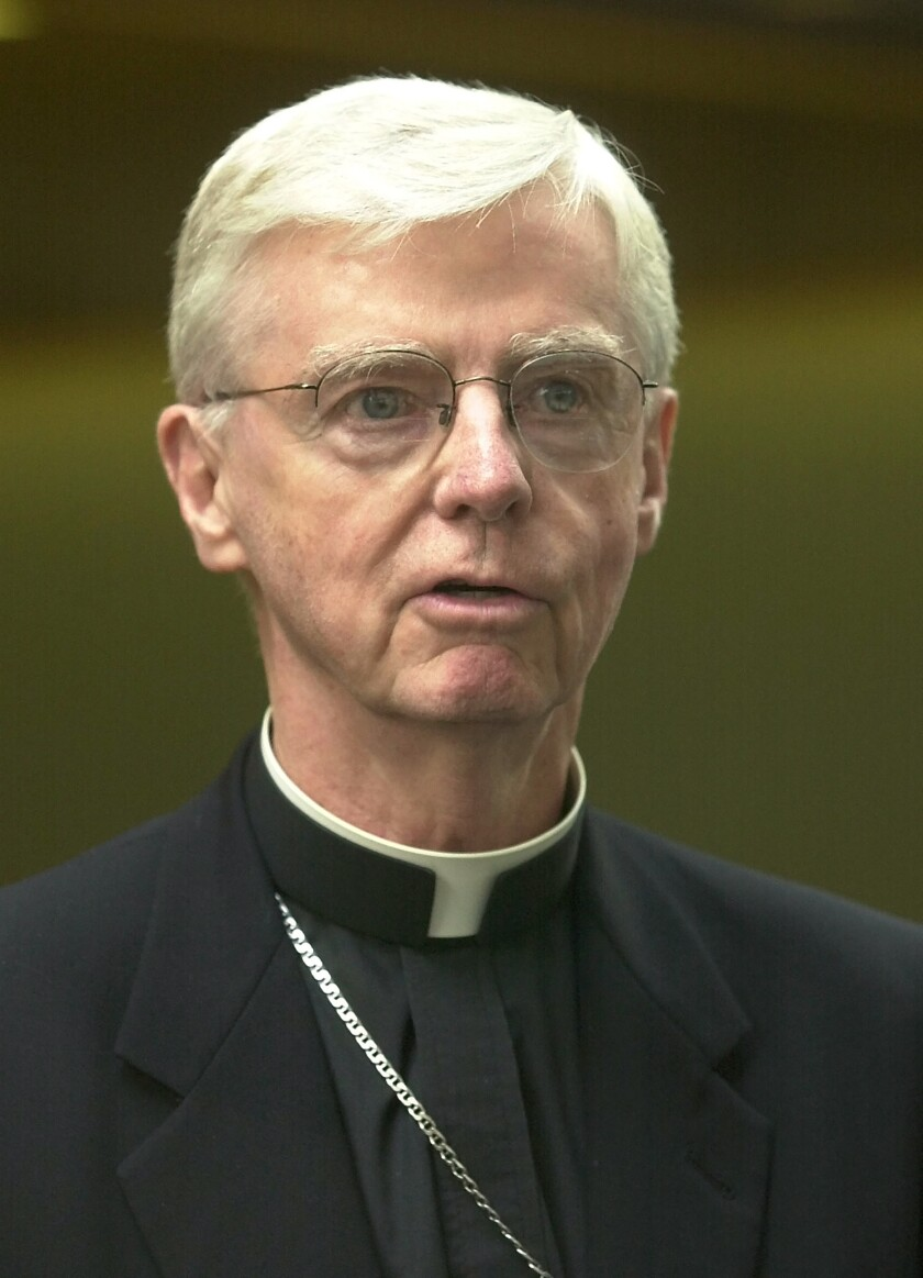 FILE — New Hampshire Bishop John McCormack speaks to reporters, in Manchester, N.H., in this Thursday, Aug. 15, 2002 file photo. McCormack, who faced criticism for his role in Boston's clergy sex abuse scandal and led New Hampshire's diocese during its own reckoning, has died. McCormack, 86, died Tuesday, Sept. 21, 2021, at Mt. Carmel Rehabilitation and Nursing Center in Manchester, according to the Diocese of Manchester. (AP Photo/Jim Cole, File)