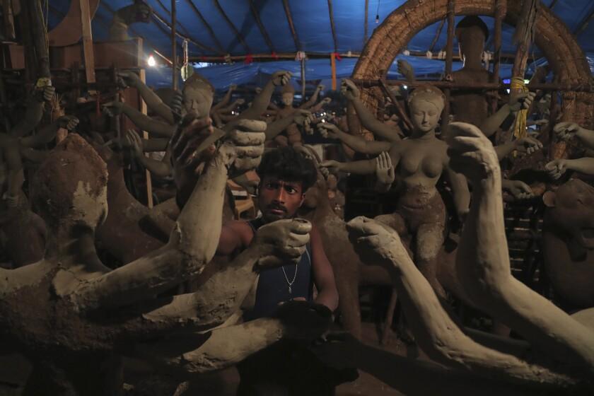 An artisan prepare a clay idol of Hindu Goddess Durga ahead of the Hindu religious festival season in Hyderabad, India, Wednesday, Oct. 7, 2020. (AP Photo/Mahesh Kumar A.)