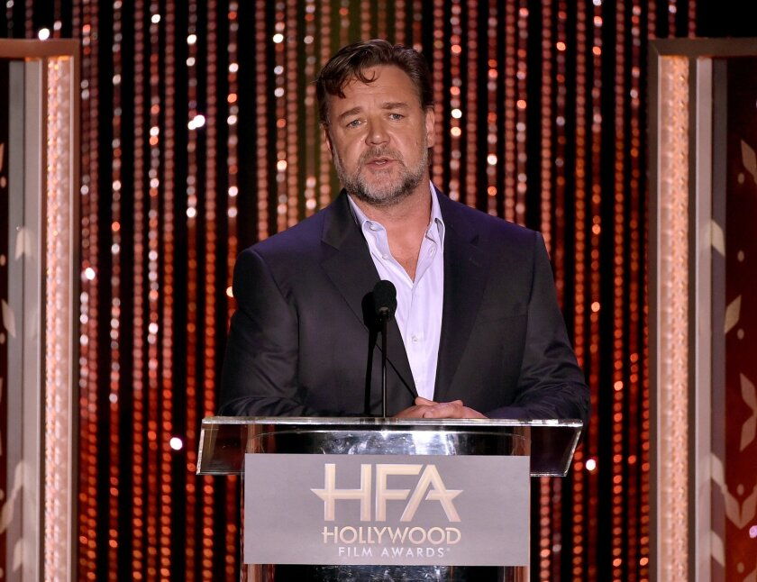 Actor Russell Crowe blasts Virgin Australia for hoverboard ban.