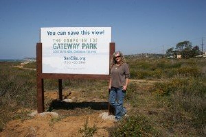 Longtime Solana Beach resident Gerri Retman-Opper stands at the Gateway Property, which she fought for decades to save. Courtesy photo