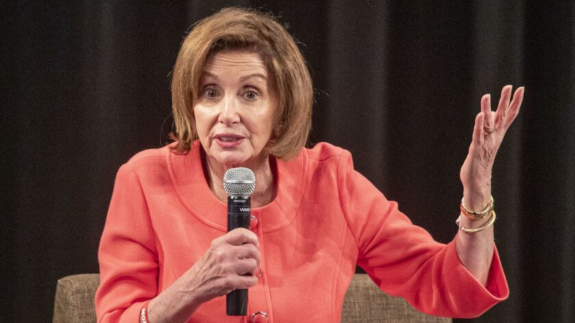 As calls for Trump impeachment grow louder, Pelosi tries to focus on