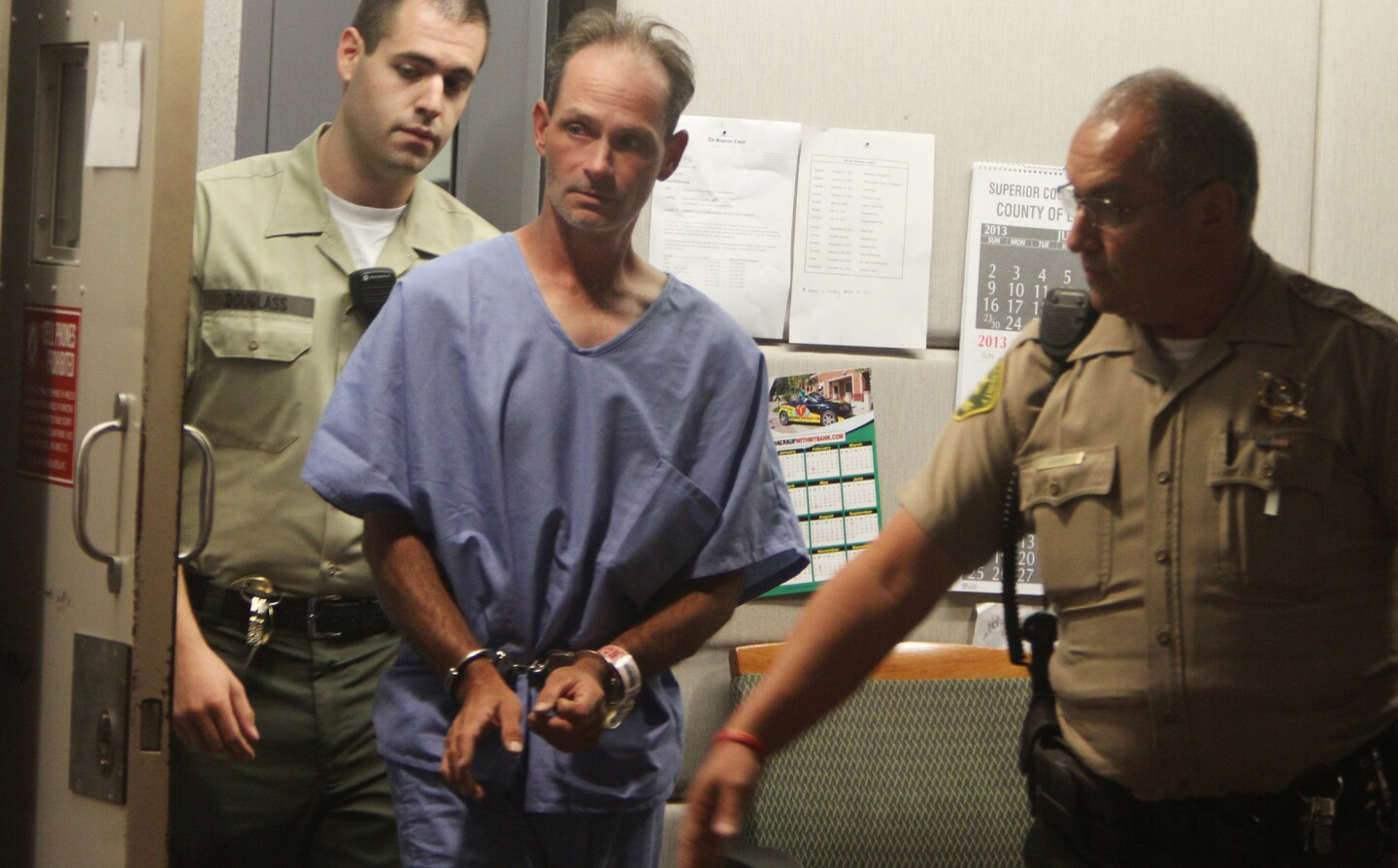 Deputies escort Nathan Louis Campbell at the Airport Courthouse, where he was arraigned Aug. 6, 2013, on charges of driving into crowds on the Venice boardwalk, killing a honeymooning Italian woman and injuring 16 others.