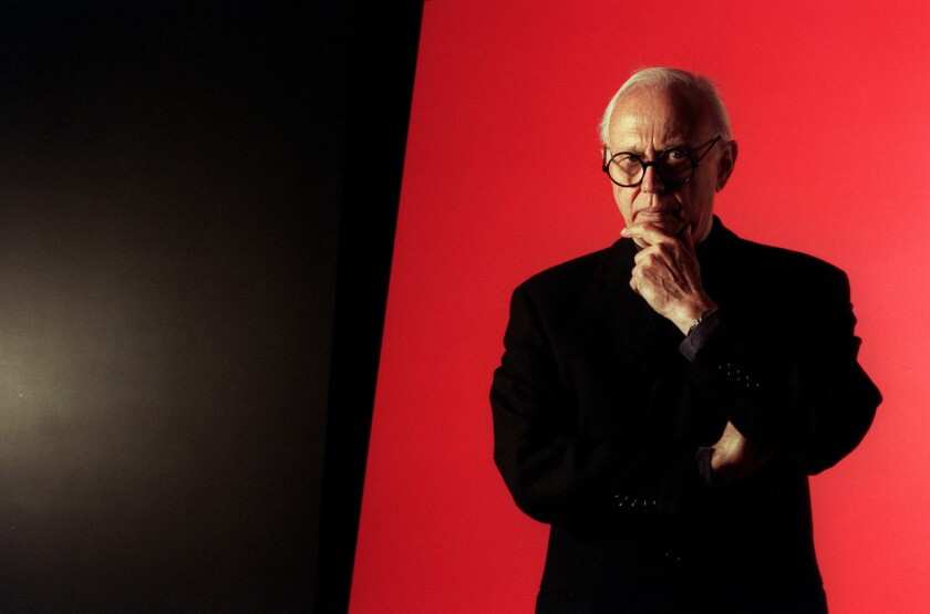 Ellsworth Kelly is photographed in front of one of his works at Peter Carlson Enterprises in Sun Valley in 1996.