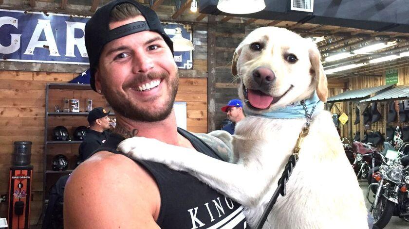 Molle, an English Labrador service dog, gives U.S. Army Ranger Veteran Justen Joslyn love and joy.