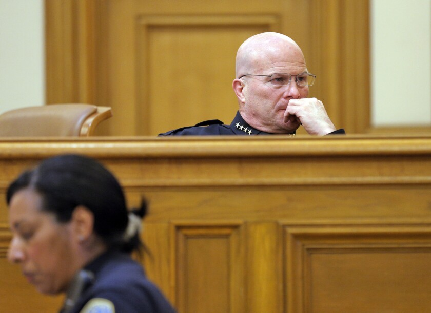 San Francisco Police Chief Greg Suhr looks at a screen during the San Francisco Police Commission meeting in April 2015 that discussed the police officers involved in racist and homophobic text messaging.
