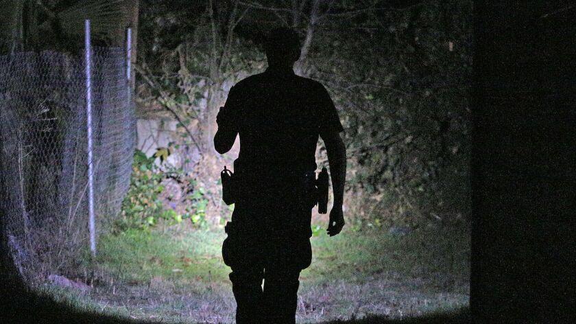 Glendale homeless outreach police officer Steve Koszis checks an area where he knows of a man who ha