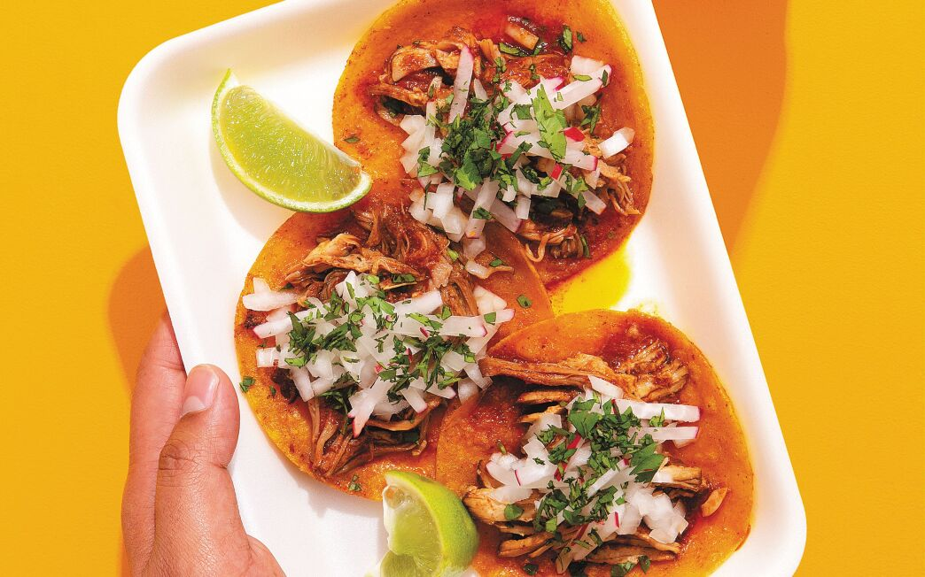 Tacos Tuxpeños, made with chile-sauce pork atop crispy fried tortillas.