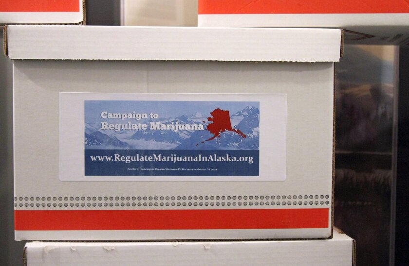 Boxes containing more than 46,000 signatures for an initiative to make recreational use of marijuana legal in Alaska sit outside a hallway at the state Division of Elections office in Anchorage, Alaska, on Wednesday, Jan. 8, 2014. If the state verifies there are enough valid signatures, the measure