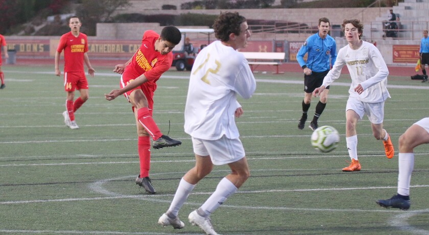 The Dons' Leo Castro-Guerrero puts a shot on goal.