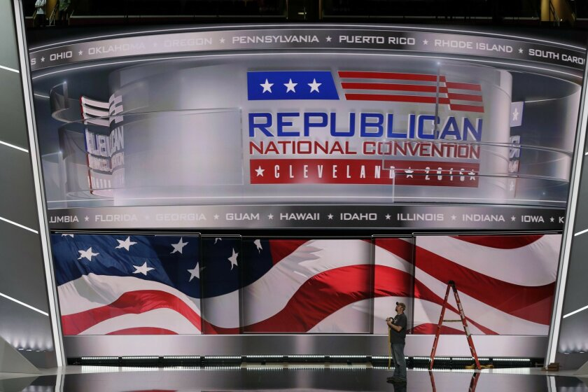A worker stands on stage as preparations continue for the Republican National Convention, Friday, July 15, 2016, at the Quicken Loans Arena in Cleveland. (AP Photo/Alex Brandon)