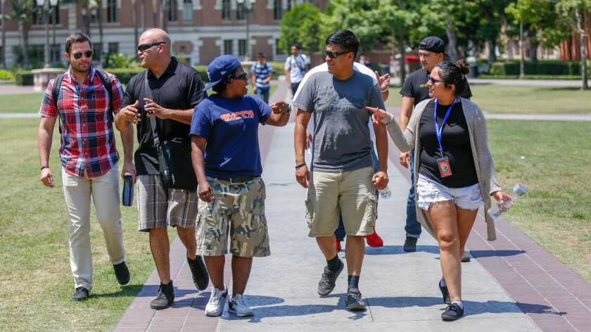 Military veterans enrolled in the Warrior Scholar Project at USC walk across campus July 28.