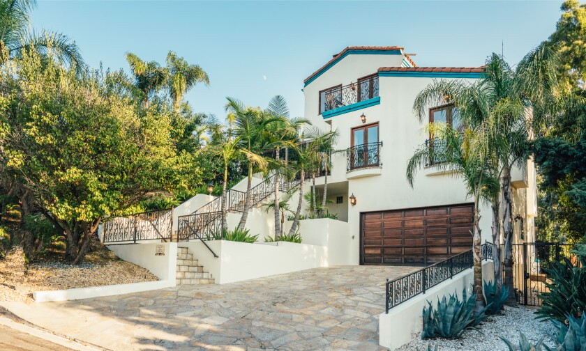 The three-story Mediterranean has wrought-iron accents, rich hardwood floors and arched doorways across 3,500 square feet.
