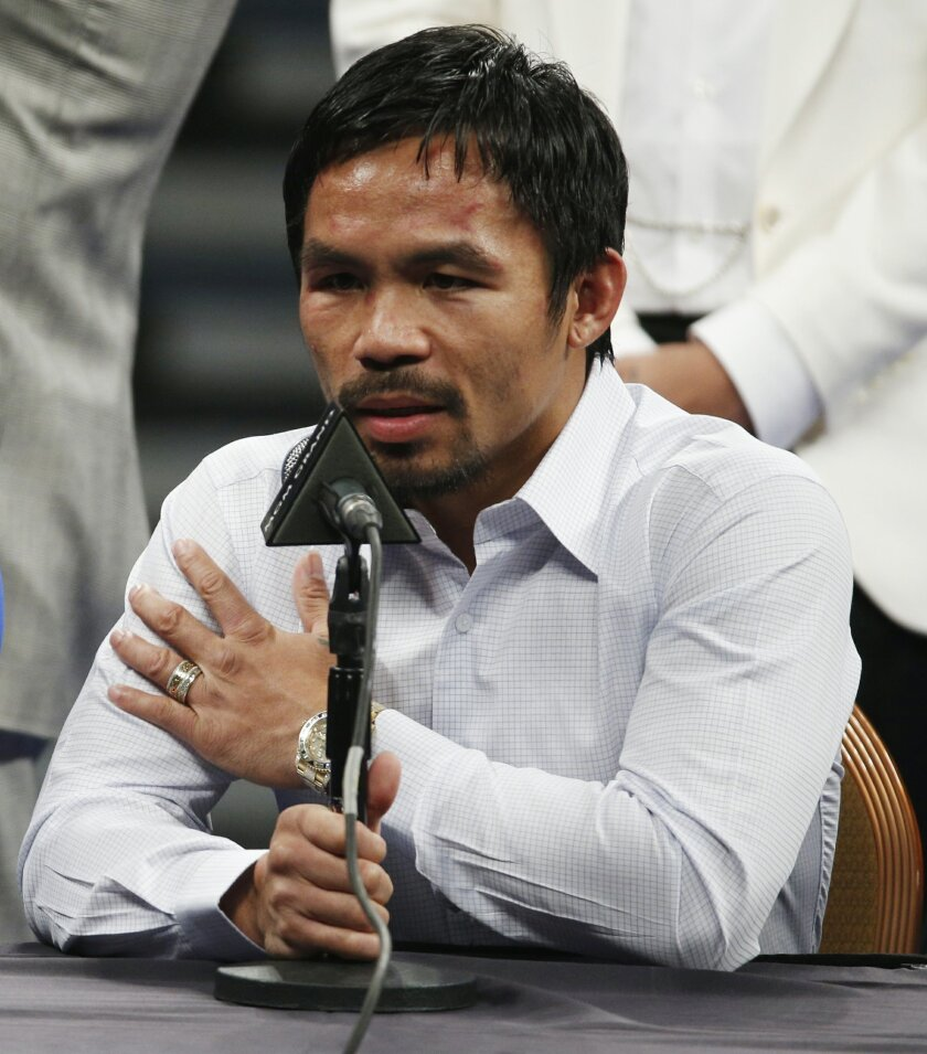 FILE - In this May 2, 2015 photo, Manny Pacquiao answers questions during a press conference following his welterweight title fight against Floyd Mayweather Jr. in Las Vegas. Pacquiao could face disciplinary action from Nevada boxing officials for failing to disclose a shoulder injury before the fi