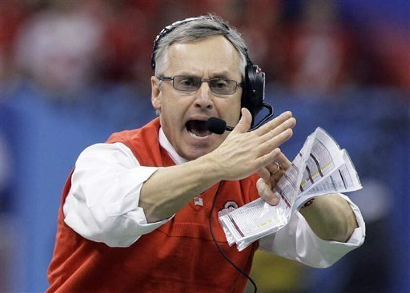 FILE - in a Jan. 4, 2011 file photo, Ohio State coach Jim Tressel signals for a timeout during the Sugar Bowl NCAA college football game against Arkansas at the Louisiana Superdome in New Orleans. Ohio State announced Monday, May 30, 2011 that football coach Jim Tressel has resigned as the NCAA investigates the Buckeyes for possible rules violations. Tressel says in a statement that he met with university officials and agreed that it is in Ohio State's best interest that he resign. The school says Luke Fickell, an assistant head coach under Tressel, will serve as interim head coach for the 2011-2012 season. (AP Photo/Patrick Semansky, File)