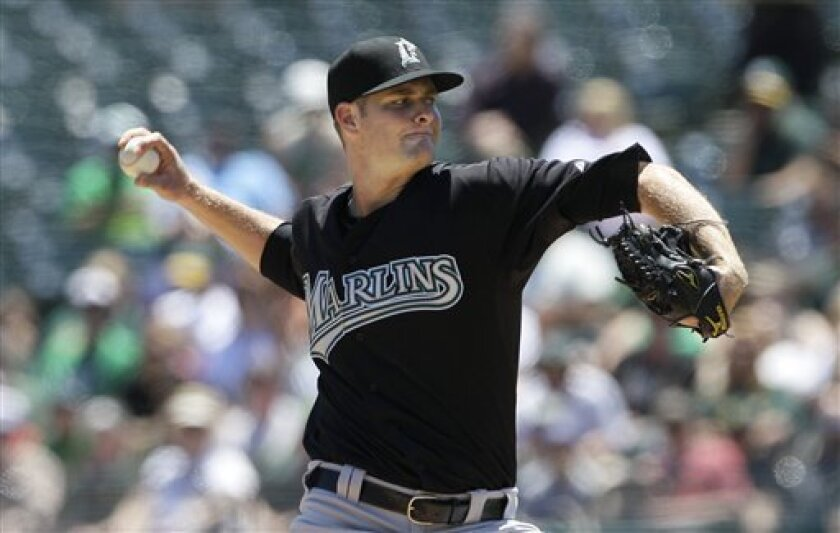 Florida Marlins pitcher Chris Volstad works against the Oakland Athletics during the first inning of an interleague baseball game in Oakland, Calif., Thursday, June 30, 2011. (AP Photo/Jeff Chiu)