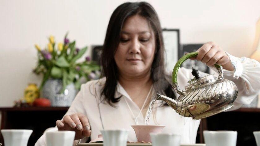 Imen Shan prepares gong fu cha, a ceremonial style of tea service, at Tea Habitat in Alhambra.