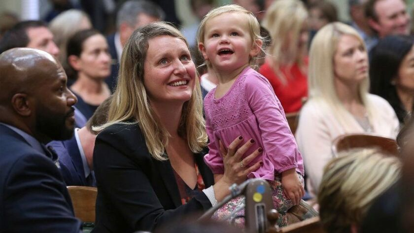 Assemblywoman Buffy Wicks, a Democrat, and her daughter, Josephine, 2, look at the Assembly Gallery during the Legislative session Dec. 3, 2018, in Sacramento.