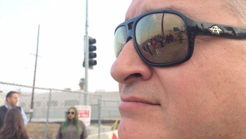 Artist Gerard Merz observes the shoot, reflected in his sunglasses.