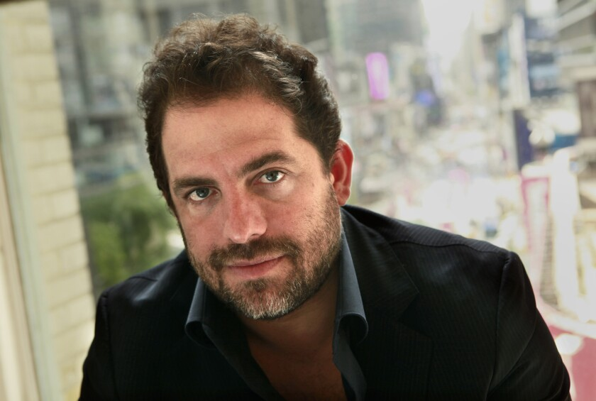 Director Brett Ratner in 2011. A woman being sued by Ratner for defamation after accusing him of rape on a Facebook post said in court filings he is attempting to intimidate and silence women.