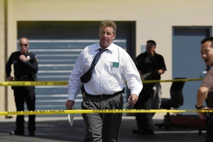 Investigators at the scene in Culver City where police killed a man they said was armed and confronted officers.