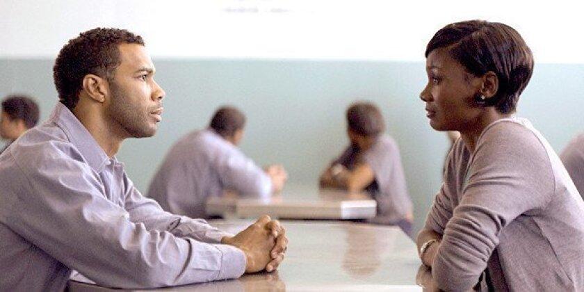 "Omari Hardwick and Emayatzy Corinealdi in the movie ""Middle of Nowhere."""