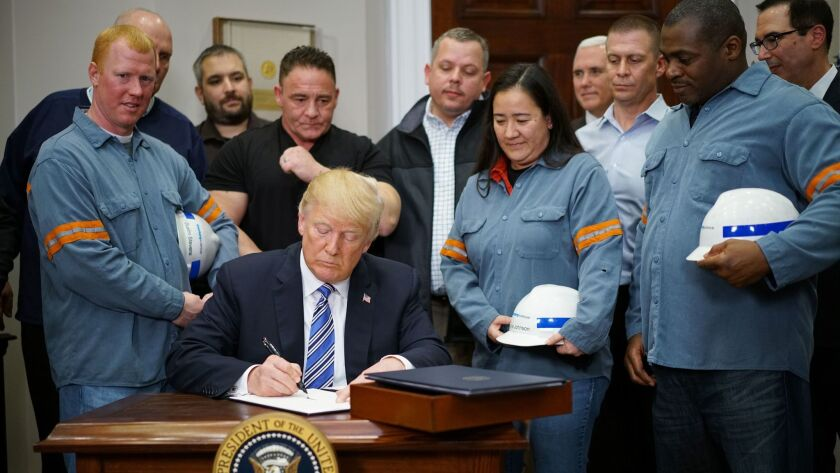 President Trump signs Section 232 Proclamations on Steel and Aluminum Imports in the Oval Office on March 8, 2018.