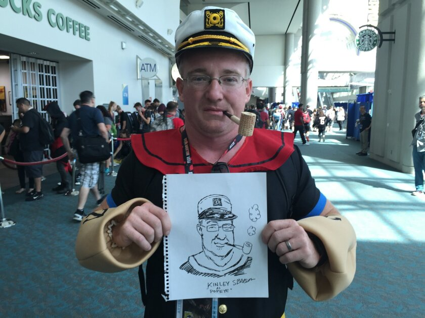 Union-Tribune editorial cartoonist Steve Breen goes one-on-one with a Popeye cosplayer at Comic-Con.