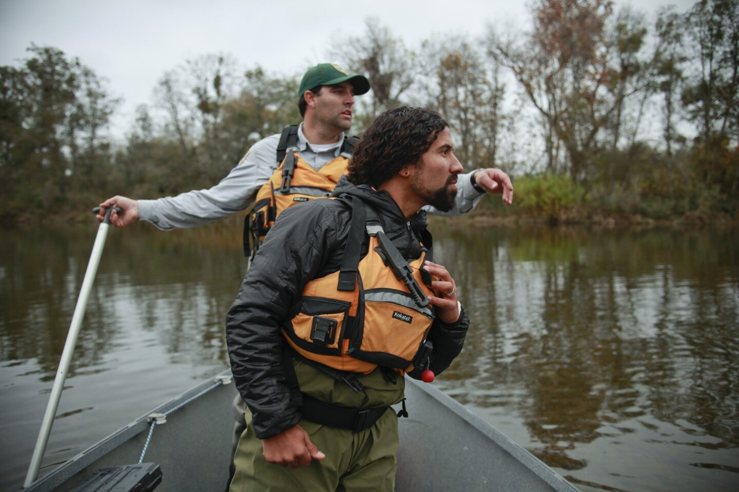 Rene Henery, California science director of Trout Unlimited (front) and Matt Bigelow, an environmental scientist with the California Department of Fish and Wildlife, spot a wild spawning chinook salmon in an upper portion of the San Joaquin River that has been devoid of salmon for more than 60 years.
