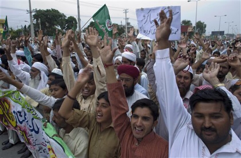 Supporters of a religious party raise their hands in support of Mumtaz Qadri, the confessed killer of a liberal Pakistani governor, during a rally to condemn a court decision against Qadri, Friday, Oct 7, 2011 in Rawalpindi, Pakistan. Supporters of the religious groups rally demand the release of Qadri. (AP Photo/B.K.Bangash)
