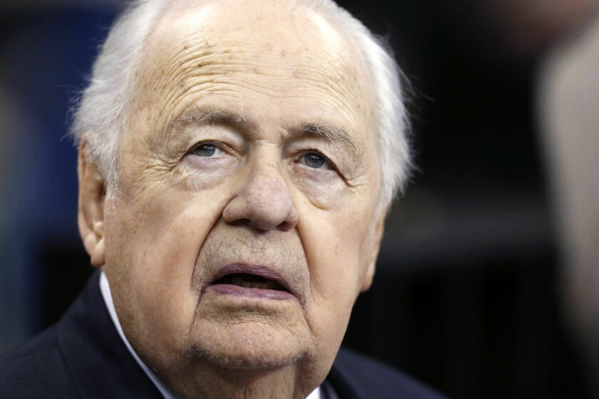 FILE - In this Sunday, Aug. 30, 2015 file photo, New Orleans Saints owner Tom Benson watches from the sideline before an NFL preseason football game against the Houston Texans in New Orleans. The New Orleans Saints are denying allegations of racism and retribution in a federal lawsuit filed in November 2015 by Rodney Henry, a fired longtime personal assistant to club owner Tom Benson.(AP Photo/Jonathan Bachman, File)