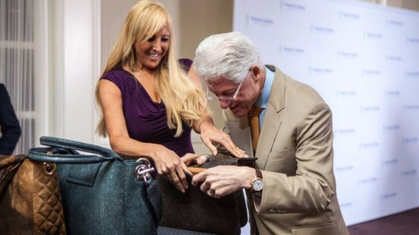 Jamah designer Nancy Gale and Bill Clinton.