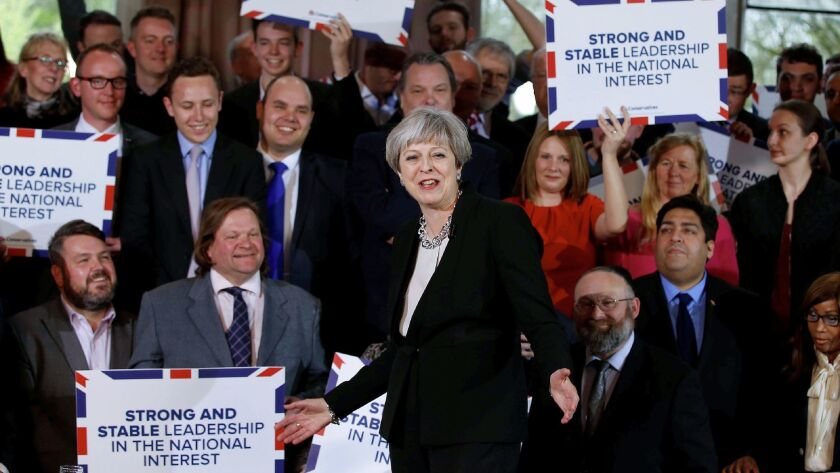 British Prime Minister Theresa May, center, delivers a speech to Conservative Party members as they launch an election campaign in Walmsley Parish Hall in Bolton on April 19, 2017.