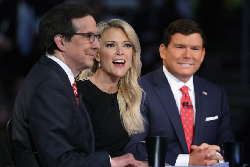 Fox News anchors Chris Wallace, left, Megyn Kelly and Bret Baier moderate the first prime-time Republican presidential debate hosted at the Quicken Loans Arena on Aug. 6, 2015, in Cleveland.