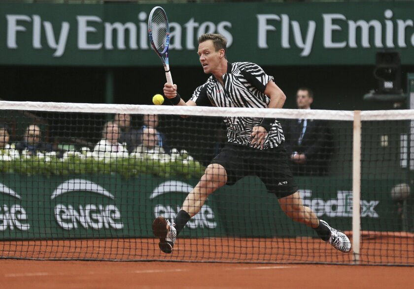 Tomas Berdych of the Czech Republic returns the ball in the quarterfinal match of the French Open tennis tournament against Serbia's Novak Djokovic at the Roland Garros stadium in Paris, France, Thursday, June 2, 2016. (AP Photo/David Vincent)